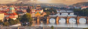 Panorama of river cruise ships on the water in Prague
