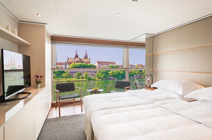 Emerald Sky's balcony suite looking out onto river cruise views