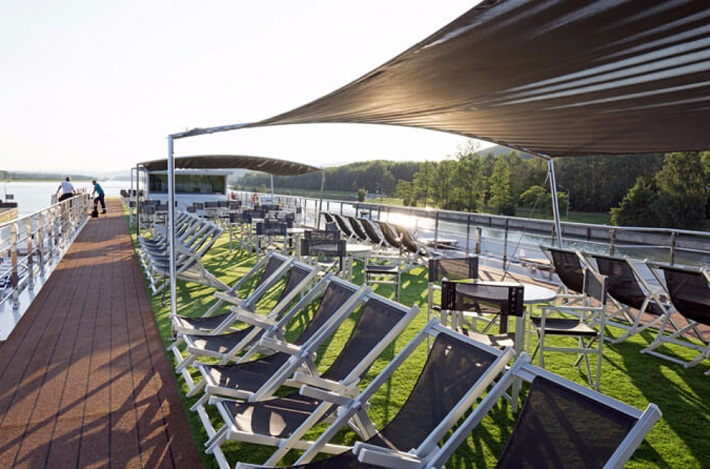 Sun loungers and artificial turf on the Emerald Sky deck