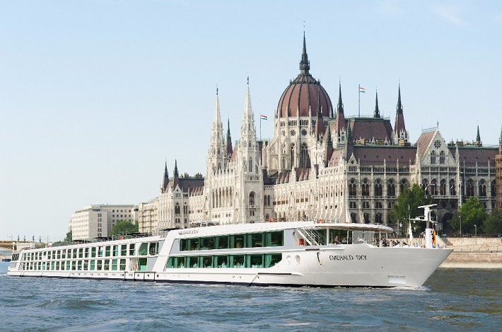 Emerald Sky sailing past a castle on a river cruise