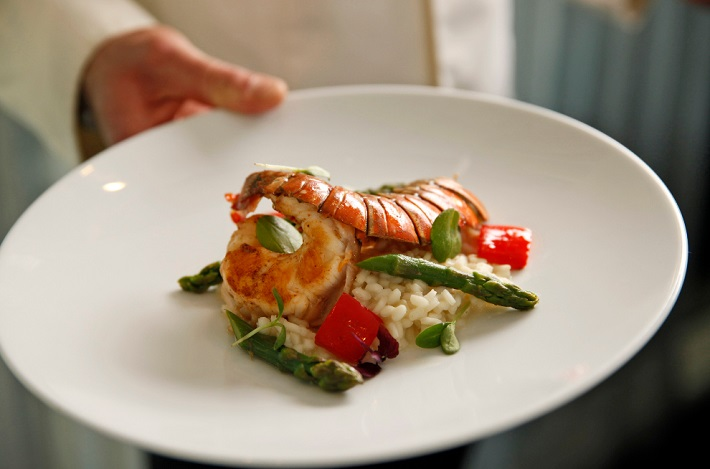 Plate of shellfish, risotto and asparagus in Scenic Amber's restaurant