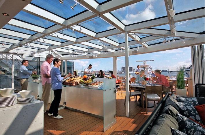 Passengers enjoying healthy food in the Aquavit lounge