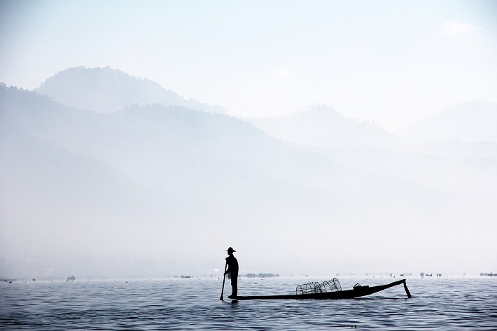 Man fishing the traditional way on the Irrawaddy River in Myanmar