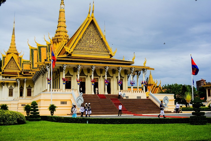People walking towards the elaborate Royal Palace in Phnom Penh