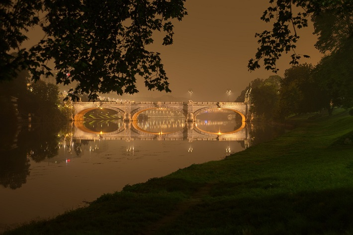 The Po River passing through Turin, in Italy, on a misty night