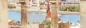 Uniworld's River Beatrice cruise ship sailing by palaces in Budapest