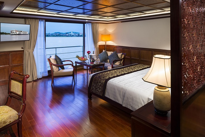 Bedroom area of a sophisticated suite on-board AmaDara