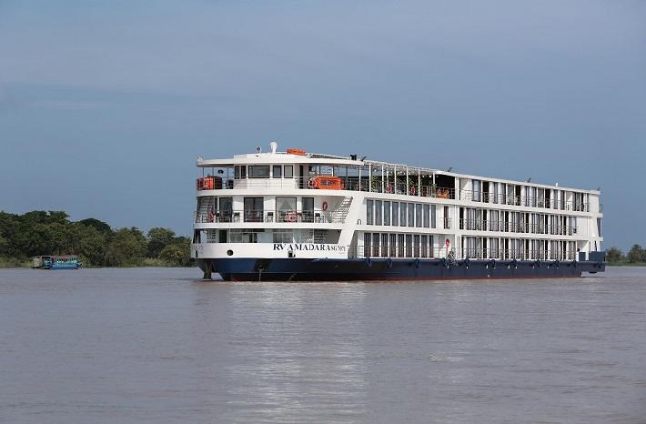 AmaDara making its way along the river on a Mekong river cruise
