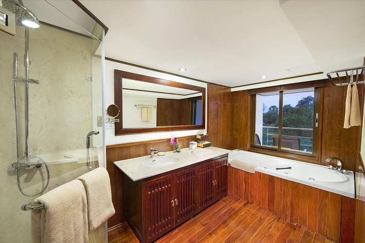 Luxurious bathroom with a shower and bath in a suite on-board AmaDara