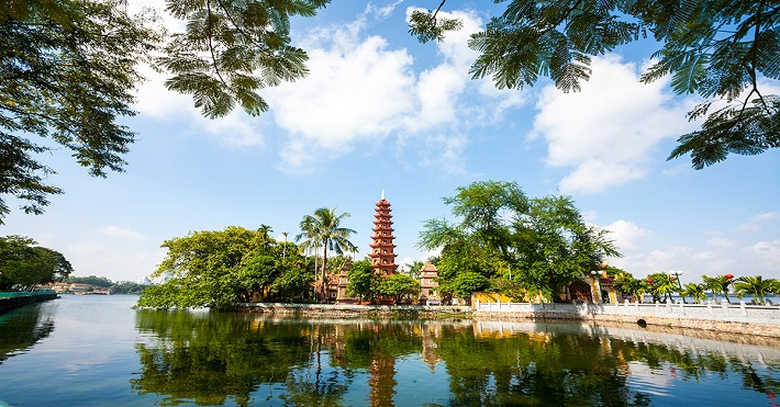 A Buddhist temple rising above the trees in Hanoi, Vietnam