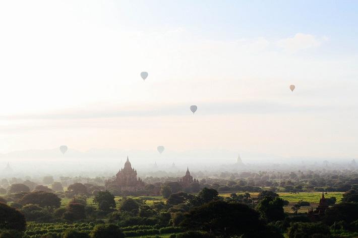 Hot air balloons drifting over Bagan on a hazy day