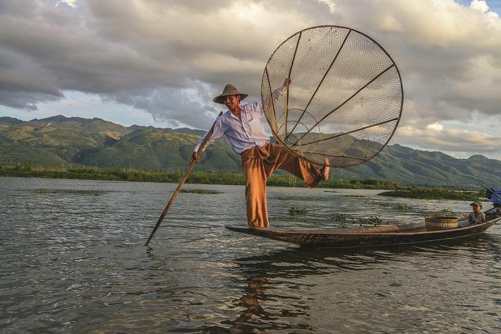 Fisherman on the Irrawaddy demonstrating traditional leg fishing