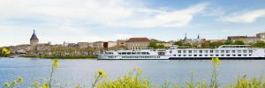 The Uniworld river cruise ship, River Royale, sailing through Blaye in France