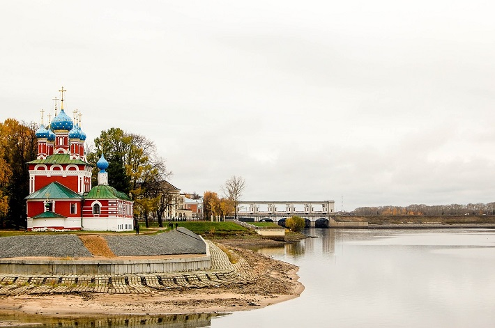Colourful Russian architecture bordering the River Volga in Uglich