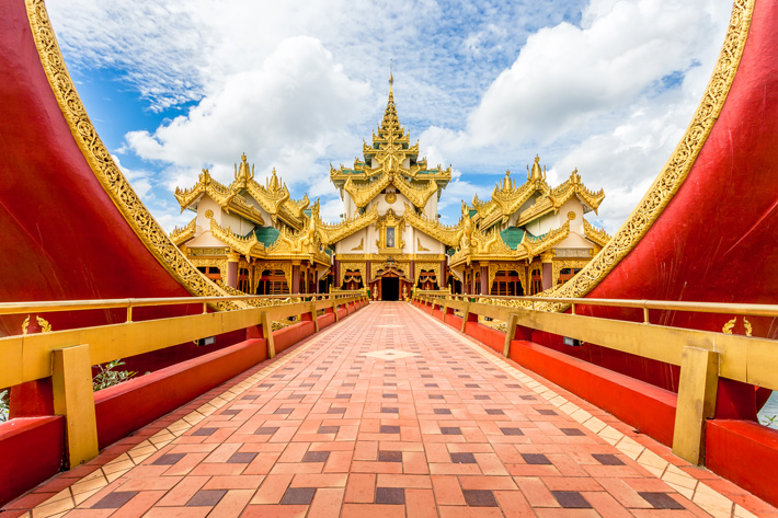 Elaborate red and gold walkway to a palace in Yangon, Myanmar