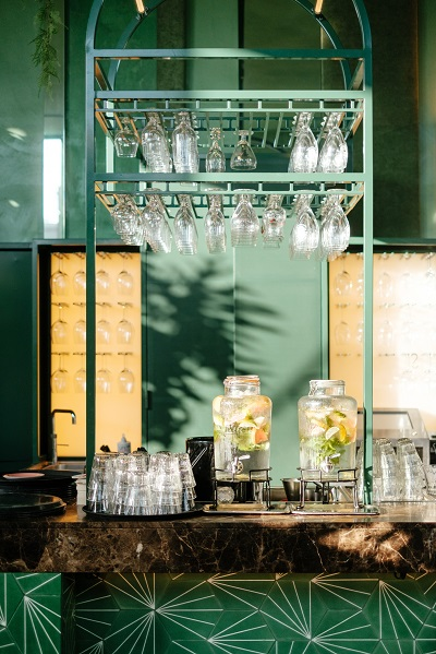 Wine glasses and jugs of water in the sophisticated bar area of a restaurant in Amsterdam