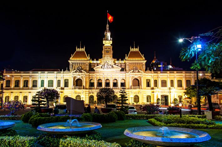 The City Hall and gardens in Ho Chi Minh City illuminated at night