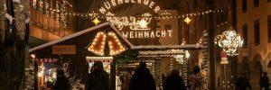People walking through Nuremberg's Christmas market at night time