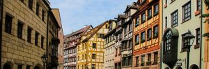 Colourful buildings lining a cobbled street in Nuremberg cruise port