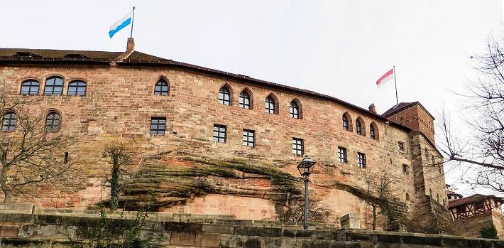 Curved exterior of medieval Kaiserburg Castle in Nuremberg
