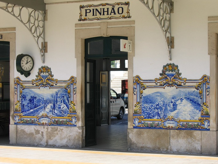 Traditional Portuguese tiles on the wall of a building in Pinhao