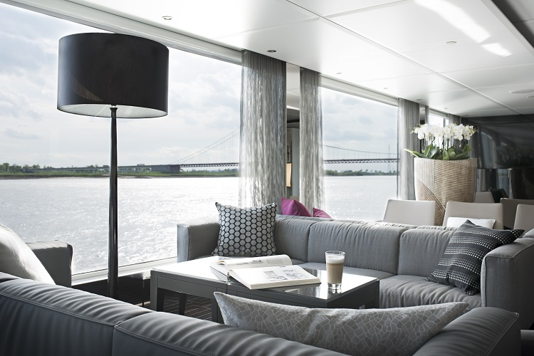 The stunning Lounge area on-board Emerald Radiance with a river view