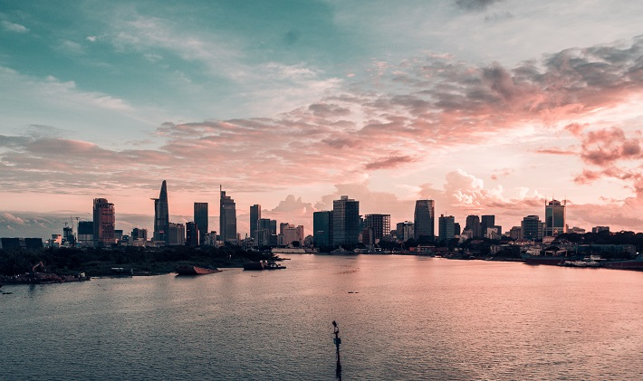 A panoramic shot of the Ho Chi Minh City skyline at sunset