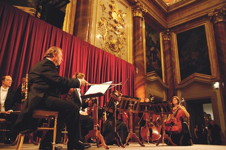 Musicians performing with cellos at Palais Liechtenstein in Austria