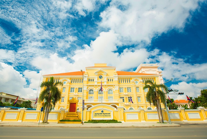 The elaborate yellow post office in Phnom Penh under a blue sky