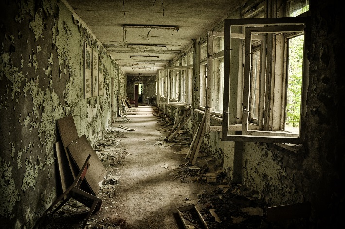 A decaying corridor in an abandoned house in Chernobyl