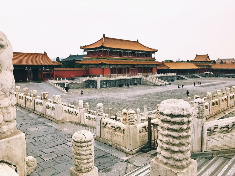People walking through the grounds of the National Palace Museum in Tiananmen Square in China