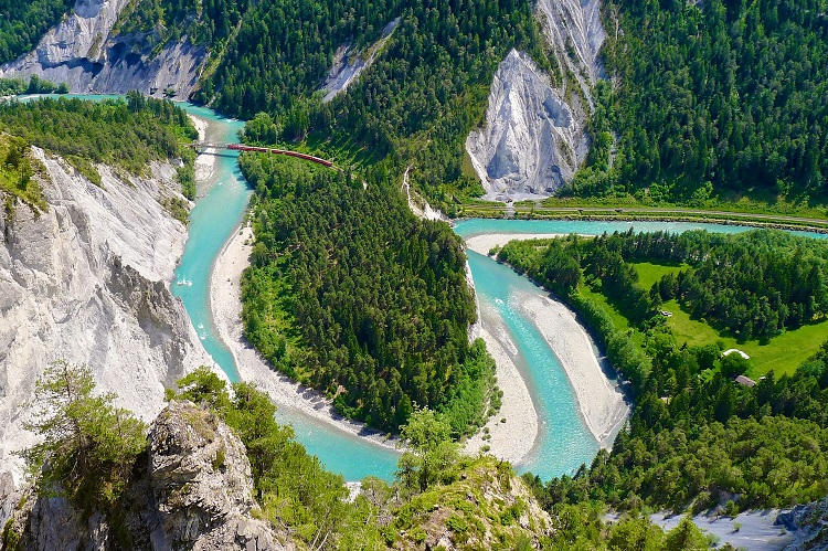 Bright blue water winding its way through the Rhine Gorge