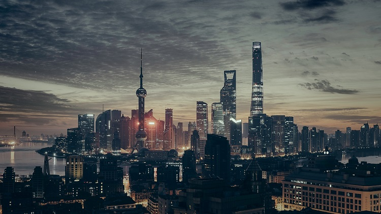 The Oriental Pearl Tower and other landmarks in the Shanghai skyline at night