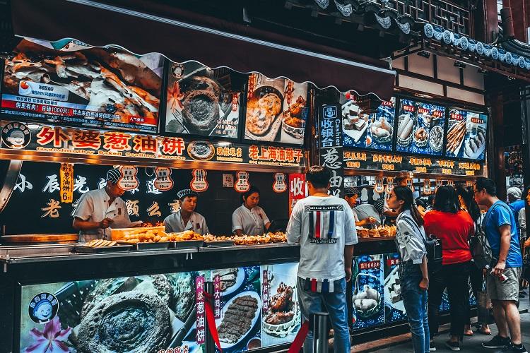 Street food vendors serving people in Shanghai