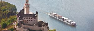 The Uniworld river cruise ship SS Antoinette sailing past a castle on the Rhine
