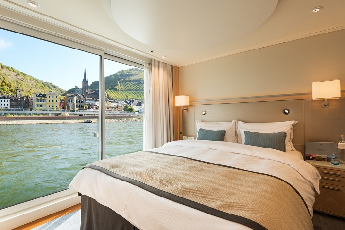 The peaceful bedroom area in a Veranda Suite on-board Viking Longship Hlin
