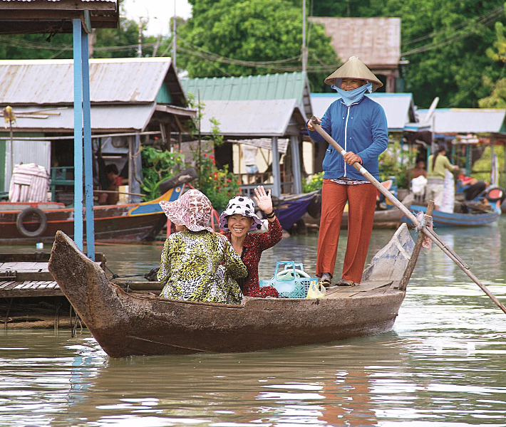 Vietnamese locals in a traditional boat
