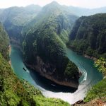 A river cruise ship passing around a bend in the Yangtze