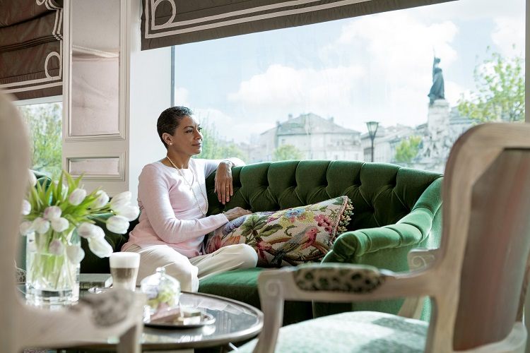 A woman relaxing in the lounge on-board Uniworld SS Catherine