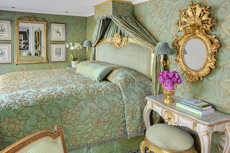 A stateroom decorated in baroque style on Uniworld's SS Maria Theresa cruise ship