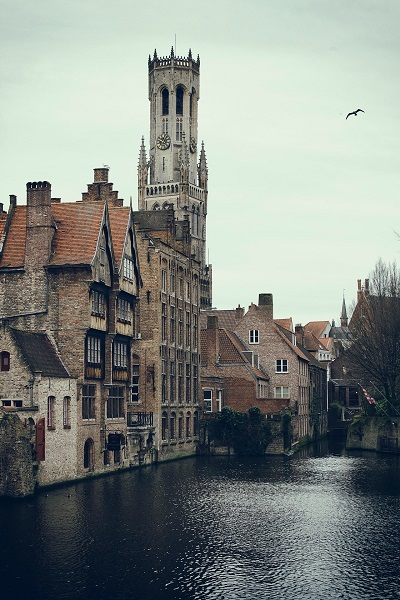 The iconic Bruges belfry seen from a canal