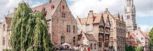 Stunning old buildings lining a canal in Bruges
