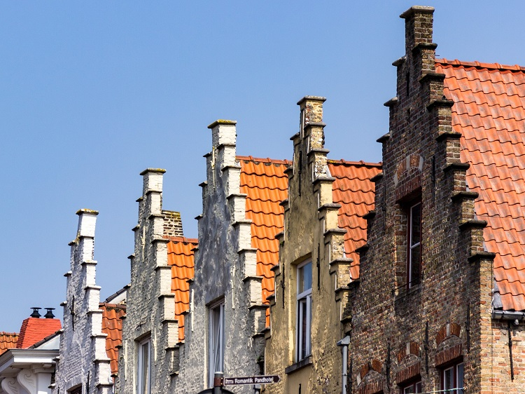 Quaint old rooftops in Bruges on a sunny day