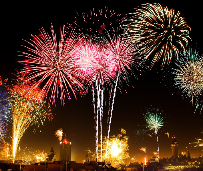 Colourful fireworks shown over Chinese cityscape - popular sight seen during Chinese New Year