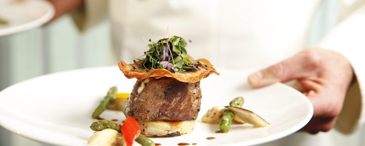 A gourmet steak dish in a restaurant on-board a Scenic river cruise ship