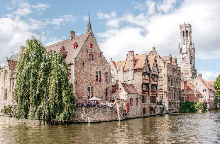 Romantic buildings in Bruges, beside the river banks