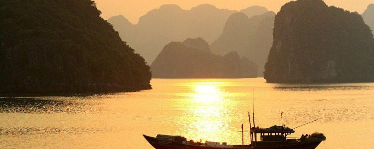 Sun setting over Ha Long Bay - a popular destination for Mekong river cruises