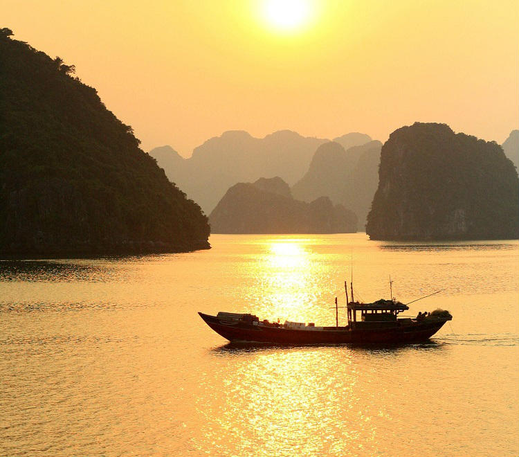 Sun setting over Halong Bay - a popular destination for Mekong river cruises