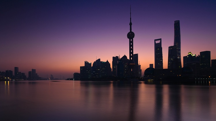 Purple and pink sunset over the skyscrapers of Shanghai - a destination on most Yangtze river cruises