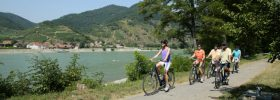 Solo river cruise guests riding bikes along the banks of the Danube
